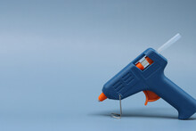Glue Gun Isolated In Blue Background