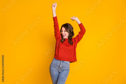 Obraz Portrait of delighted girl enjoy lottery win raise fists scream yeah wear good look sweater isolated over bright color background - fototapety do salonu