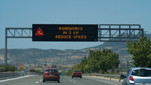Road Sign In Greek Highway Wit...
