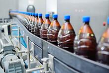 Plastic Beer Bottles On A Conv...