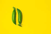 Green Pea Pods On A Yellow Bac...