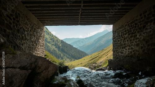 Obraz Mountain landscape with river passes under the bridge - fototapety do salonu