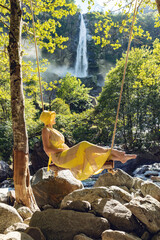 Girl with a yellow dress in the nature