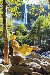 Beautiful girl sitting on a swing.