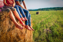 Kids Sitting On Haystack In Wh...