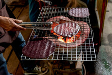 People Making Snacks Grill With Charcoal Stove Has A Name Called Puk, Which Sesame Rice Is A Meal Or Snack, Native Of Northern Thailand In Night Market, To Street Food Concept.