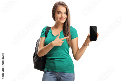 Cuadros en Lienzo Casual young woman with a backpack showing a smartphone