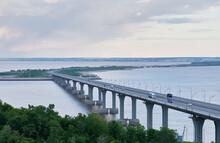 Bridge Over River. Magpie Mountains. Bridge Over The Kama River. Evening Summer Landscape. Big Bridge With Cars