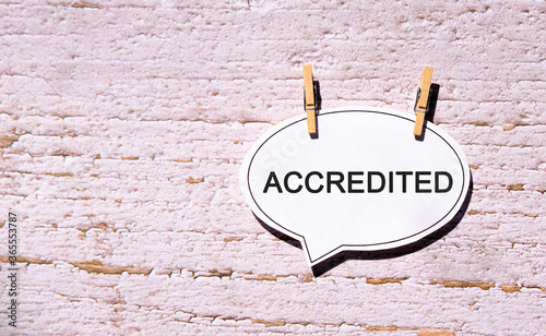 Photo Accredited on a white sheet with wooden pins