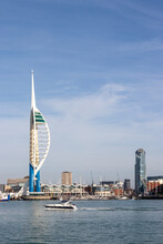 The Spinnaker Tower With A Speedboat In The Foreground And Gunwharf Quays With The Spinnaker Tower In The Background