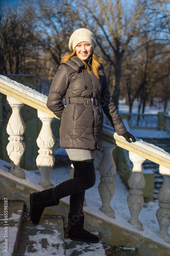 Fototapeta Beautiful young blonde girl in winter. obraz na płótnie