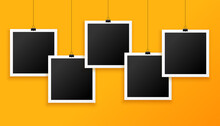 Five Hanging Photo Frames On Y...