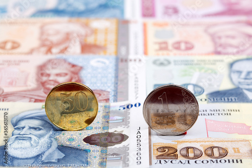 Obraz na plátně Tajikistani coins - somoni on the background of money