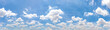 Leinwandbild Motiv Panorama or panoramic photo of blue sky and white clouds or cloudscape. for breathing concepts background.