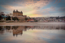 Victorian Architecture Of The Scarborough Hotel Reflected On The Beach As The Tide Comes In At Sunset