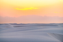 White Sands National Park Monument Sand Dunes In New Mexico With Organ Mountains Silhouette On Horizon During Colorful Red Yellow Sunset