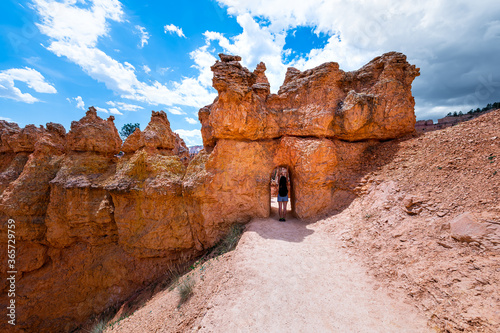 Slika na platnu Young woman standing in desert landscape tunnel arch in Bryce Canyon National Pa