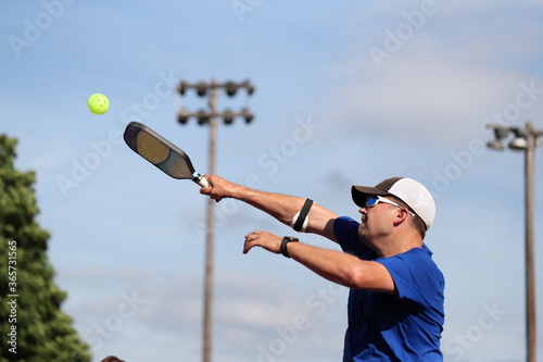 Photo A pickleball overhead is hit during match