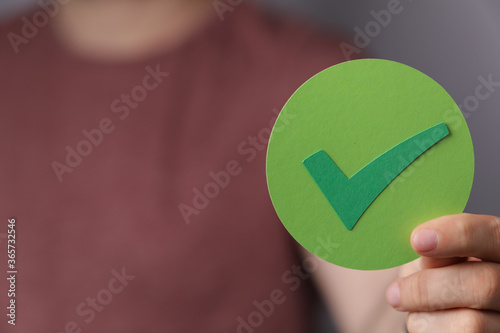 Photo check mark in hand paper