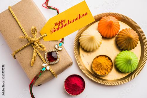 Obraz Indian festival Raksha Bandhan with rakhi bracelets, presents, rice and kumkum in bowls. Copy space - fototapety do salonu