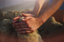 Young Caucasian Woman Making A Sandcastle. Close-up Of Hands.