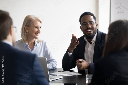 Young adults employees gather for briefing, during formal meeting multi ethnic p Fototapet