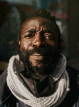 Portrait Of A Black Homeless Man With A Beard In A Street