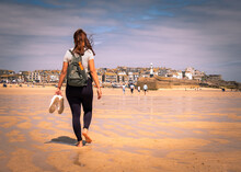 Woman Walking Bare Feet On The Beach In St Ives, Cornwall- UK