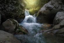 Sunlight Illuminates A Waterfa...
