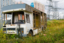 An Abandoned Bus On The Outskirts Of The City