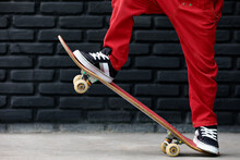 Young Skater With Skateboard H...