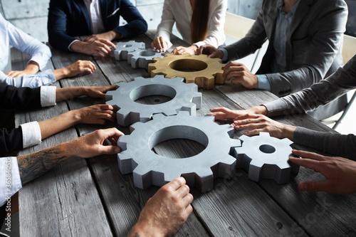 Fotografie, Obraz Business people joining gears