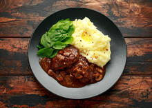Salisbury Steak With Mushroom Gravy, Mashed Potatoes And Spinach On Rustic Wooden Table