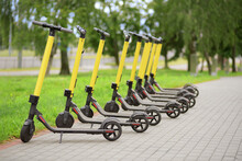 Yellow Motorized Scooters Arra...