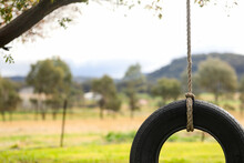 Close Up Image Of Tire Swing With Mountain Landscape In Background