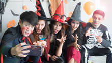 Group Of 5 Friends Taking Selfie At Halloween Costume Party. Halloween Holidays And Technology Concept.