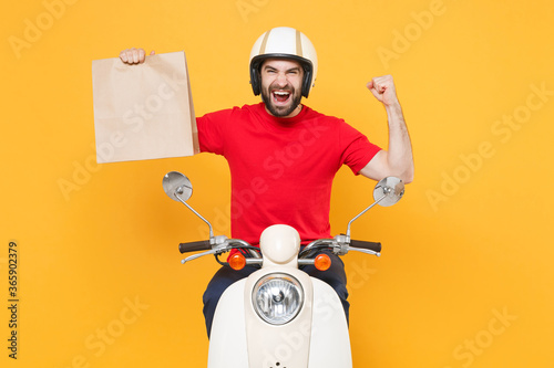 Delivery man helmet red t-shirt uniform driving moped motorbike scooter hold cra Wallpaper Mural
