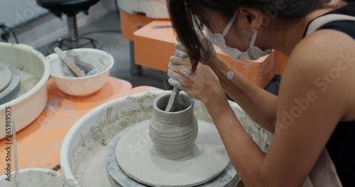 Slika na platnu Woman make pottery wheel, shaping a clay pot