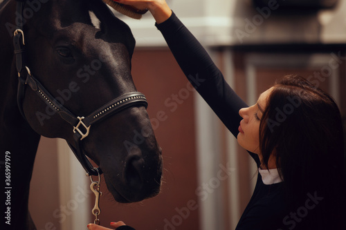 Canvas Equestrian sport - young girl rides on horse.