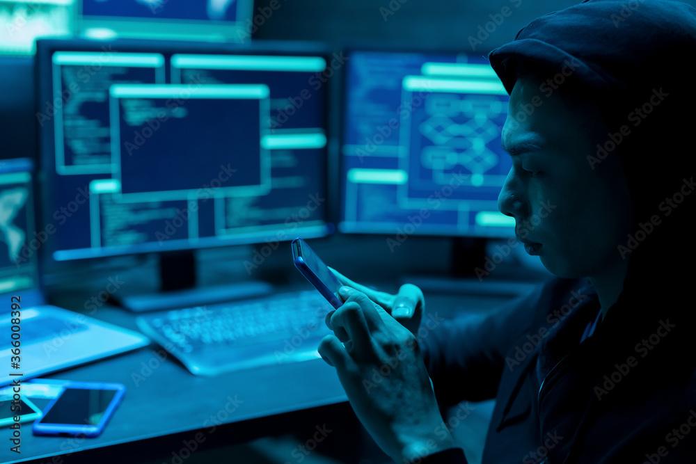 Fototapeta closeup of asian male hacker