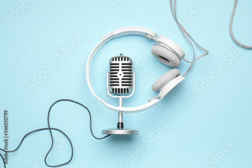 Headphones with microphone on color background Fototapeta