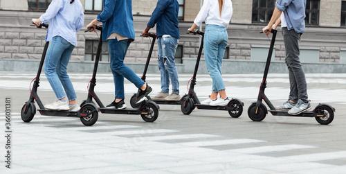 Friends having ride on motorized kick scooters Fototapeta