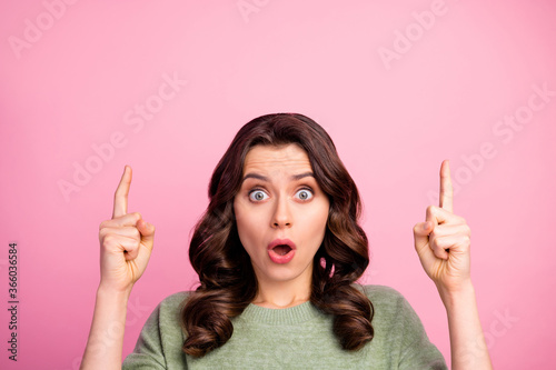 Fototapeta Portrait of astonished girl point index finger copyspace indicate wonderful adve