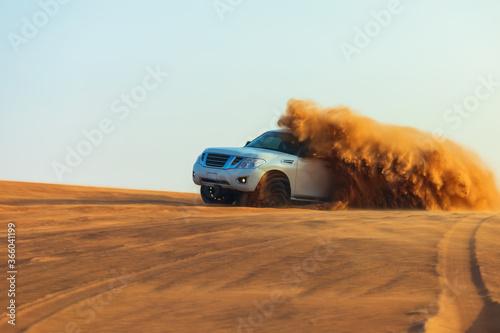 Stampa su Tela Offroad drifting adventure with 4x4 car dune bashing through sand dunes in desert