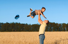 Father Throwing Boy In Sky