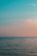 Tropical ocean and sky blue and pink gradient. Wallpaper, copy space.