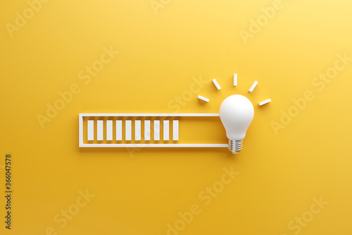 Loading bar almost complete with idea beeing processed on a light bulb on yellow background Slika na platnu