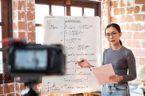 Leinwand Poster Asian woman teacher teaching lesson online learning via internet at home, self s