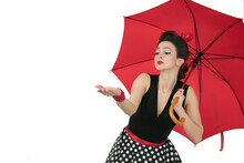 Retro Woman In Polka Dot Dress With Red Umbrella
