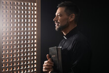 Male Priest In Confession Booth